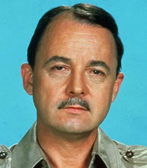 Higgins (John Hillerman)